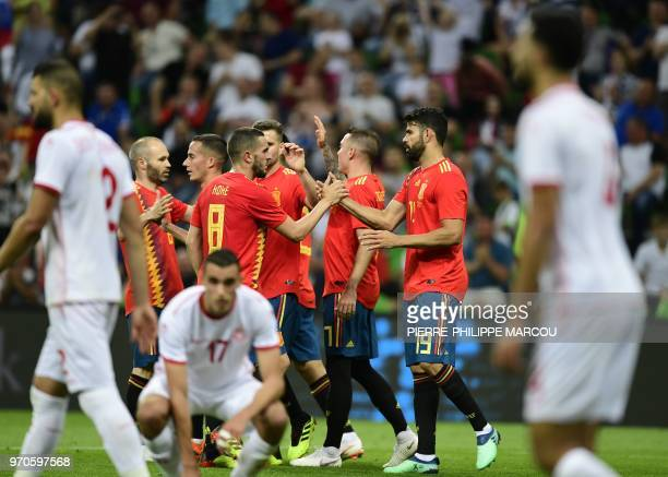Spain's forward Iago Aspas celebrates with team mates after scoring a goal during the friendly football match between Spain and Tunisia at...