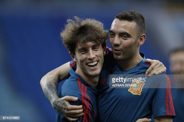 Spain's forward Iago Aspas embraces defender Alvaro Odriozola during a training session with his teammates at the Fisht Olympic Stadium in Sochi on...