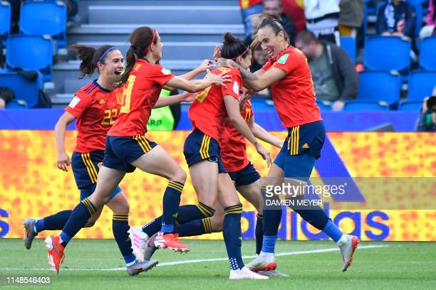Spain's forward Jennifer Hermoso celebrates with teammates after scoring a penalty kick during the France 2019 Women's World Cup Group B football...