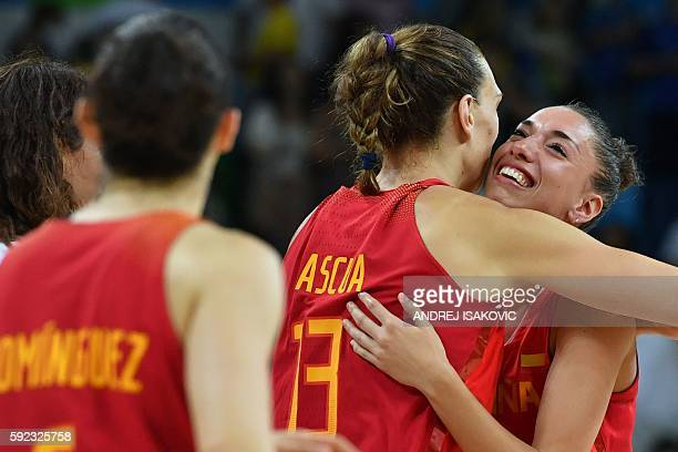 Spain's forward Laura Quevedo embraces Spain's centre Lucila Pascua after USA defeated Spain during a Women's Gold medal basketball match between USA...