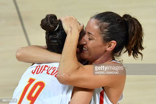 Spain's forward Laura Quevedo embraces Spain's point guard Laia Palau after defeating Turkey during a Women's quarterfinal basketball match between...