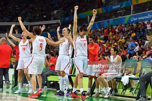 Spain's forward Laura Quevedo Spain's point guard Laia Palau Spain's centre Lucila Pascua and Spain's power forward Laura Nicholls celebrate...