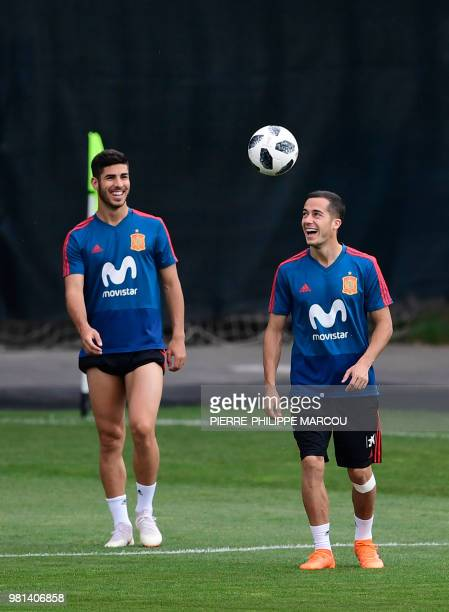 Spain's forward Marco Asensio Willemsen and Spain's forward Lucas Vazquez attend a training session at Krasnodar Academy on June 22 during the Russia...