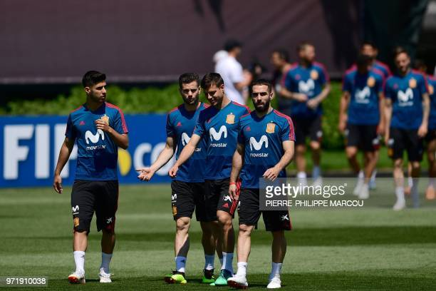Spain's forward Marco Asensio Willemsen defender Nacho Fernandez defender Cesar Azpilicueta and defender Dani Carvajal arrive to take part in a...