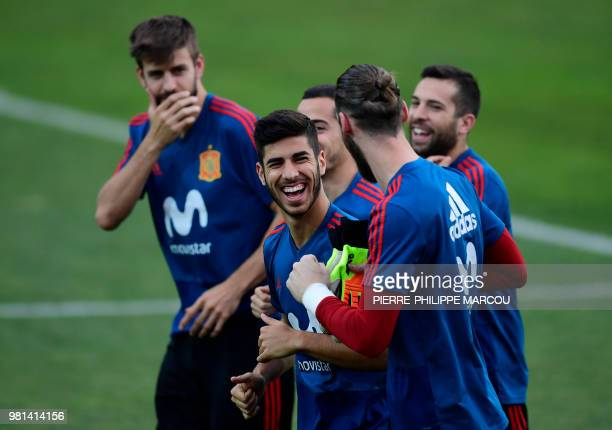 Spain's forward Marco Asensio Willemsen laughs during a training session at Krasnodar Academy on June 22 during the Russia 2018 World Cup football...