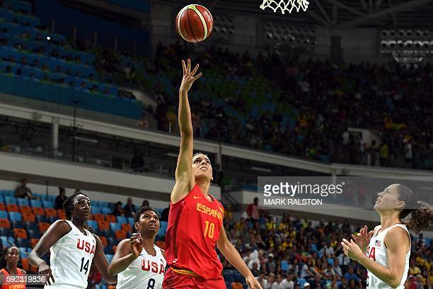 Spain's forward Marta Xargay goes to the basket as USA's centre Tina Charles USA's small forward Angel Mccoughtry and USA's guard Sue Bird look on...