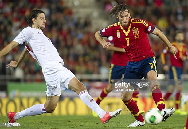 Spain's forward Michu vies with Belarus' defender Yegor Filipenko during the WC2014 qualifying football match Spain vs Belarus at the Iberostar...