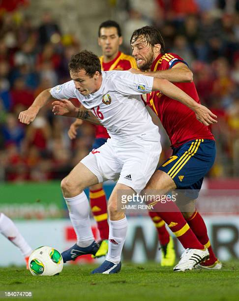 Spain's forward Michu vies with Belarus' midfielder Sergei Balanovich during the WC2014 qualifying football match Spain vs Belarus at the Iberostar...