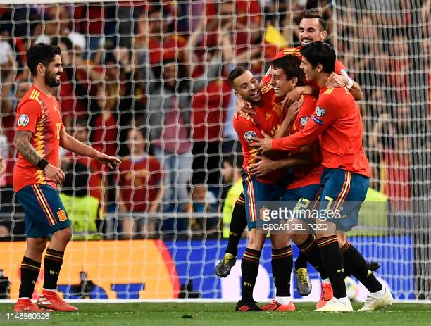 TOPSHOT Spain's forward Mikel Oyarzabal celebrates his goal with teammates during the UEFA Euro 2020 group F qualifying football match between Spain...