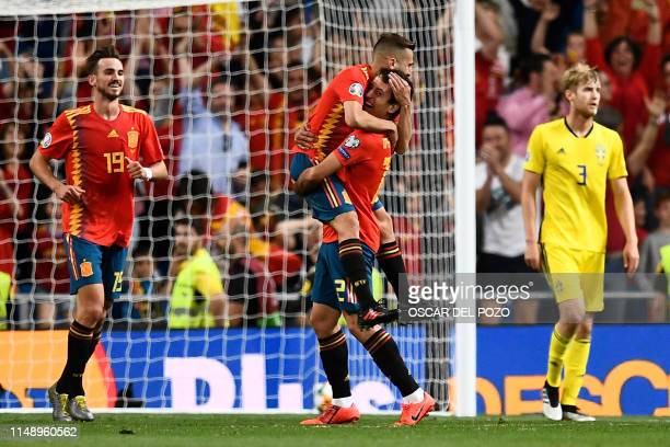 Spain's forward Mikel Oyarzabal celebrates his goal with teammates during the UEFA Euro 2020 group F qualifying football match between Spain and...