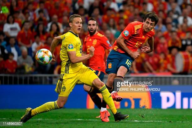 Spain's forward Mikel Oyarzabal scores during the UEFA Euro 2020 group F qualifying football match between Spain and Sweden at the Santiago Bernabeu...
