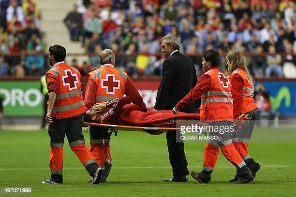 Spain's forward Paco Alcacer is strechered off by medical staff during the Euro 2016 qualifying football match Spain vs Luxembourg at Las Gaunas...