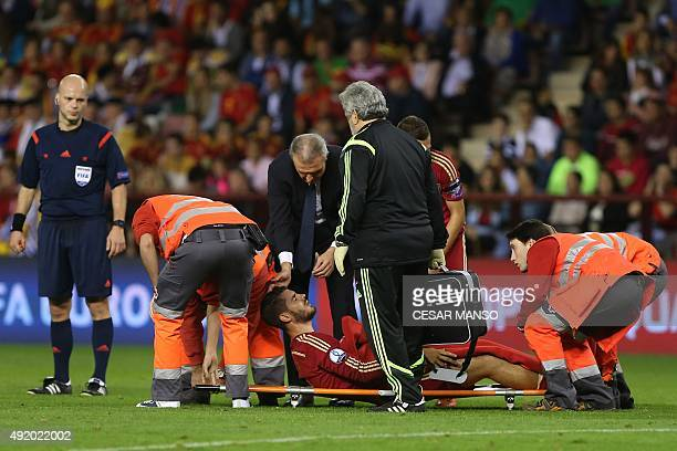 Spain's forward Paco Alcacer put on a stretcger by medical staff during the Euro 2016 qualifying football match Spain vs Luxembourg at Las Gaunas...