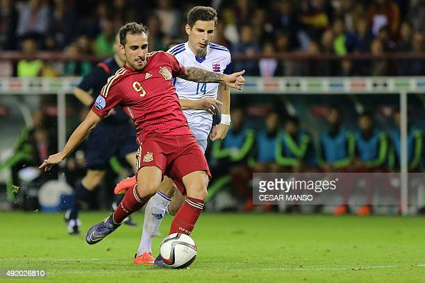 Spain's forward Paco Alcacer scores during the Euro 2016 qualifying football match Spain vs Luxembourg at Las Gaunas stadium in Logrono on October 9...