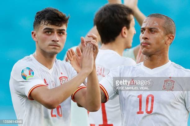 Spain's forward Pedri and Spain's midfielder Thiago Alcantara applaud after the UEFA EURO 2020 Group E football match between Slovakia and Spain at...