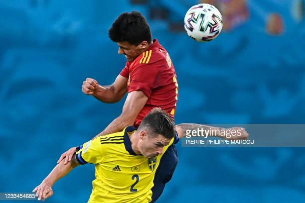 Spain's forward Pedri heads the ball with Sweden's defender Mikael Lustig during the UEFA EURO 2020 Group E football match between Spain and Sweden...