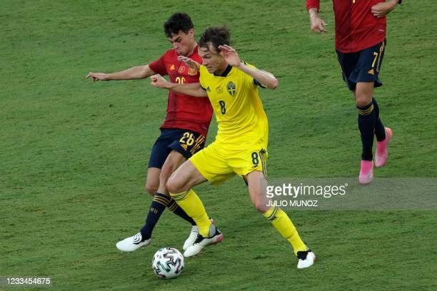 Spain's forward Pedri vies for the ball with Sweden's midfielder Albin Ekdal during the UEFA EURO 2020 Group E football match between Spain and...