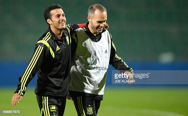 Spain's forward Pedro and midfielder Andres Iniesta leave Spain team's practice on the eve of EURO 2016 qualifing match between Slovakia and Spain in...