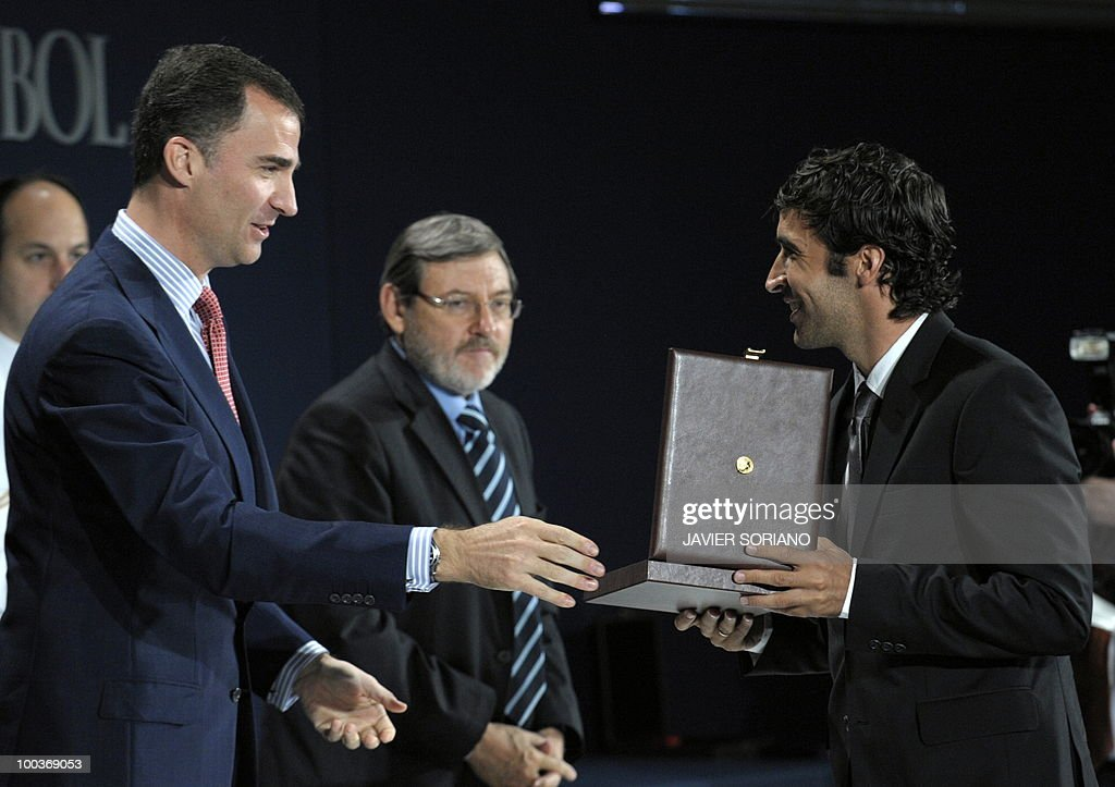 Spain's forward Raul Gonzalez (R) receives from Spain's Prince Felipe (L) the Gold Medal for Sports Merit during the inauguration of RFEF museum on May 24, 2010 at the Sports City of Las Rozas, near Madrid. Spain, among the favourites for the World Cup, which runs from June 11-July 11, face Switzerland, Honduras and Chile in Group H of the opening round.