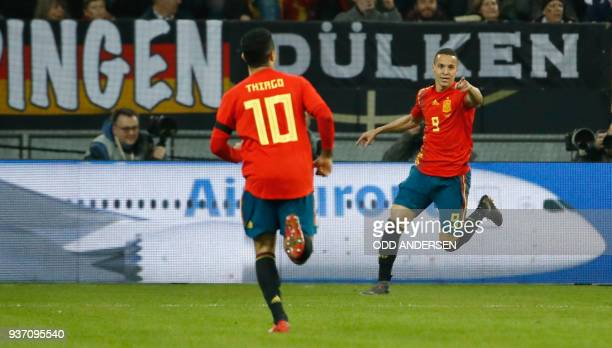 Spain's forward Rodrigo celebrates after scoring the 01 during the international friendly football match of Germany vs Spain in Duesseldorf western...