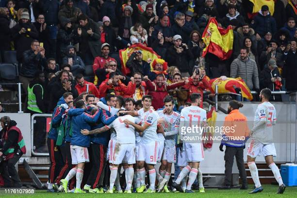 Spain's forward Rodrigo celebrates with his teammates after scoring the 11 equaliser during the UEFA Euro 2020 Group F qualification football match...