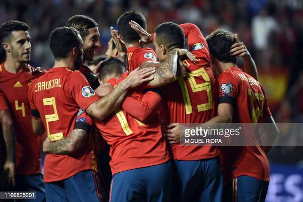 Spain's forward Rodrigo celebrates with teammates scoring the opening goal during the UEFA Euro 2020 qualifier group F football match between Spain...
