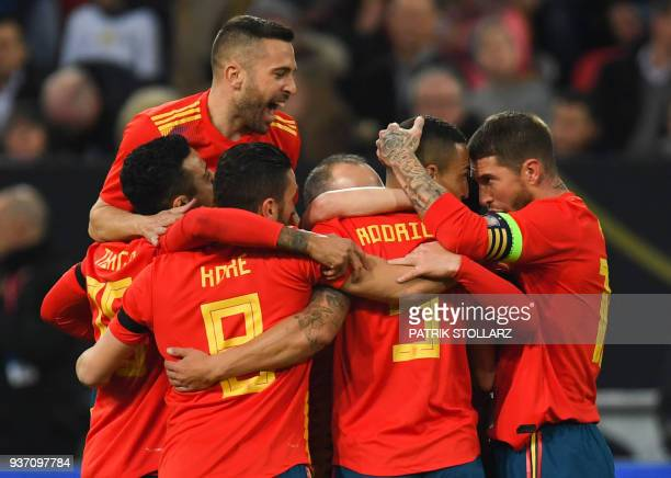 Spain's forward Rodrigo hidden is congratulated by teammates after he scored the 01 during the international friendly football match of Germany vs...