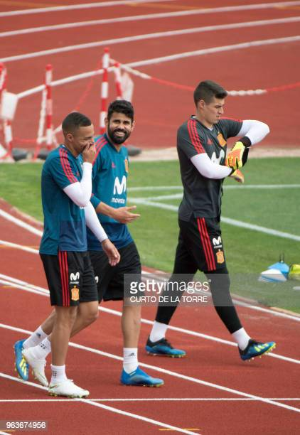 Spain's forward Rodrigo Spain's forward Diego Costa and Spain's goalkeeper Kepa Arrizabalaga arrive for a training session at the Spanish Football...