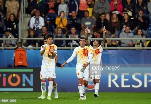 Spain's forward Sandro Ramirez celebrate after scoring woth his teammates during the UEFA U21 European Championship Group B football match Portugal v...
