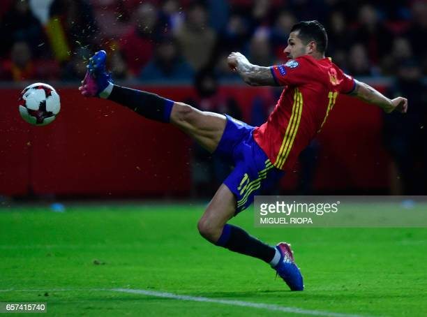 Spain's forward Vitolo tries to kick a goal during the WC 2018 group G football qualifing match Spain vs Israel at El Molinon stadium in Gijon on...