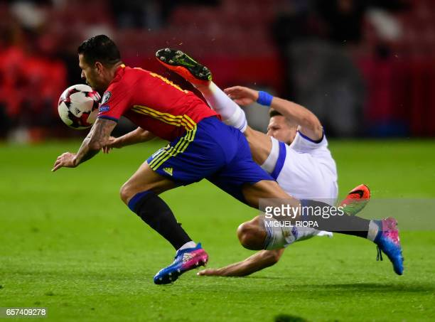 Spain's forward Vitolo vies with Israel's defender Rami Gershon during the WC 2018 group G football qualifing match Spain vs Israel at El Molinon...