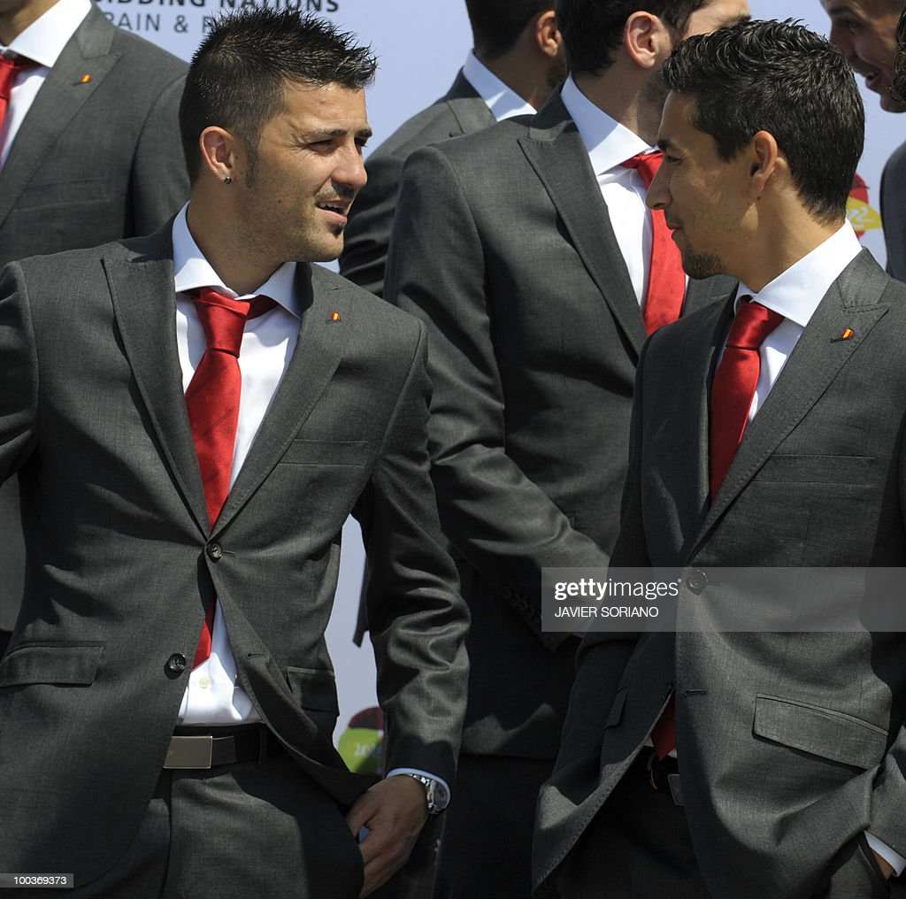 Spain's forwards David Villa and Jesus Navas chat before a group picture during the inauguration of Spanish Football Federation (RFEF) museum on May 24, 2010 at the Sports City of Las Rozas, near Madrid. Spain, among the favourites for the World Cup, which runs from June 11-July 11, face Switzerland, Honduras and Chile in Group H of the opening round.