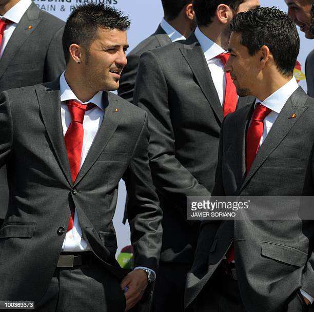 Spain's forwards David Villa and Jesus Navas chat before a group picture during the inauguration of Spanish Football Federation museum on May 24 2010...