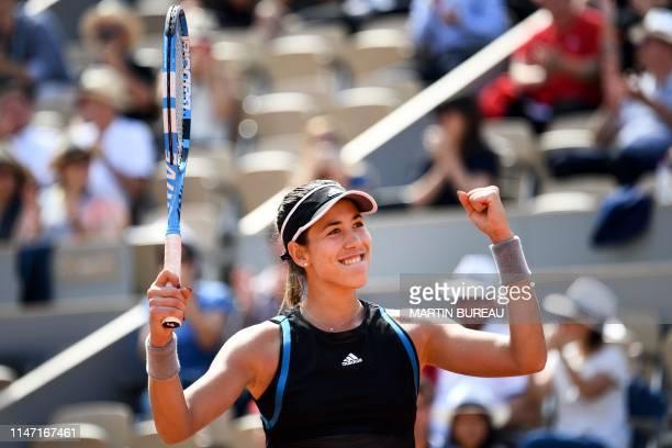 Spain's Garbine Muguruza celebrates after winning against Ukraine's Elina Svitolina during their women's singles third round match on day six of The...