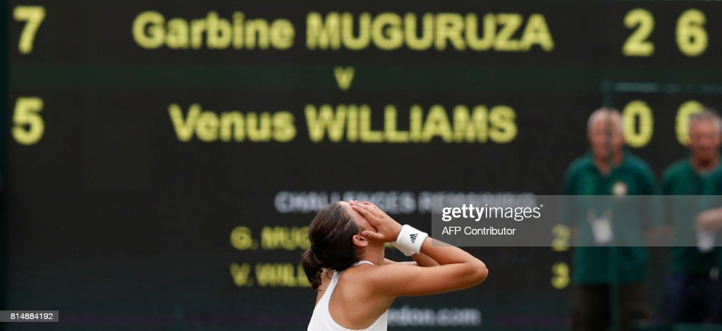 Spain's Garbine Muguruza celebrates after winning against US player Venus Williams during their women's singles final match on the twelfth day of the 2017 Wimbledon Championships at The All England Lawn Tennis Club in Wimbledon, southwest London, on July 15, 2017. Muguruza won 7-5, 6-0. / AFP PHOTO / Adrian DENNIS / RESTRICTED