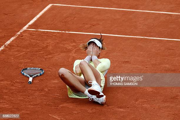 TOPSHOT Spain's Garbine Muguruza celebrates after winning her women's final match against US player Serena Williams at the Roland Garros 2016 French...