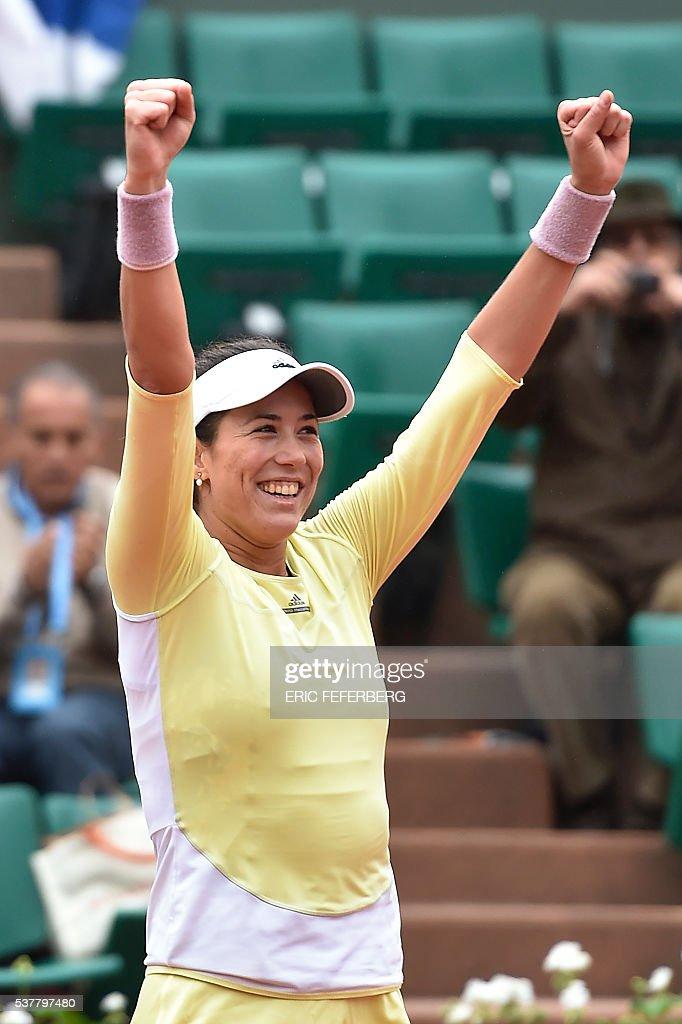 Spain's Garbine Muguruza celebrates after winning her women's semi-final match against Australia's Samantha Stosur at the Roland Garros 2016 French Tennis Open in Paris on June 3, 2016. / AFP / Eric FEFERBERG