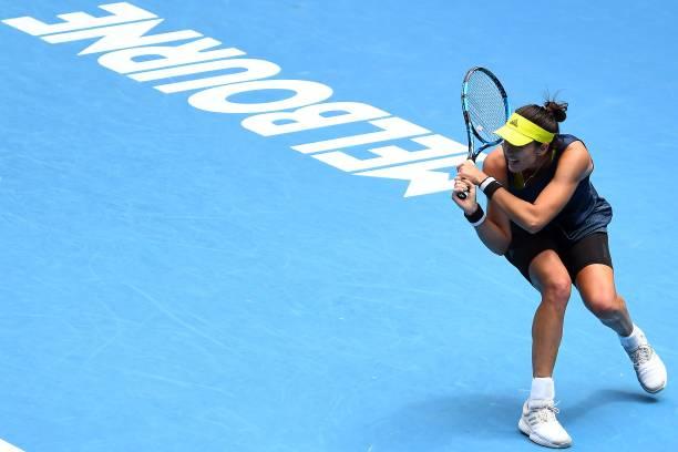 Spain's Garbine Muguruza hits a return against Japan's Naomi Osaka during women's singles match on day seven of the Australian Open tennis tournament...