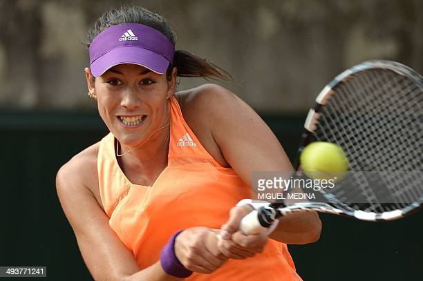 Spain's Garbine Muguruza hits a return to USA's Grace Min during their French tennis Open first round match at the Roland Garros stadium in Paris on...