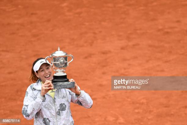 TOPSHOT Spain's Garbine Muguruza holds the trophy after winning her women's final match against US player Serena Williams at the Roland Garros 2016...