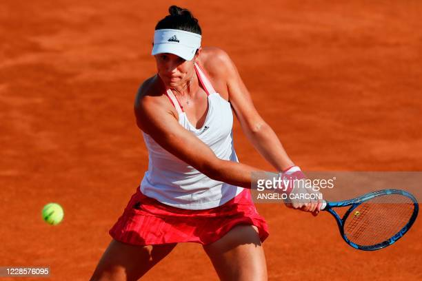 Spain's Garbine Muguruza plays a backhand to Britain's Johanna Konta during their round 3 match on day five of the Women's Italian Open at Foro...