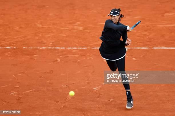 Spain's Garbine Muguruza plays a forehand return to Slovenia's Tamara Zidansek during their women's singles first round tennis match on Day 2 of The...