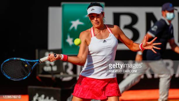 Spain's Garbine Muguruza plays a forehand to Britain's Johanna Konta during their round 3 match on day five of the Women's Italian Open at Foro...