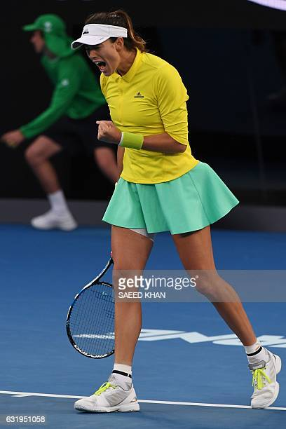 Spain's Garbine Muguruza reacts after a point against Samantha Crawford of the US during their women's singles match on day three of the Australian...