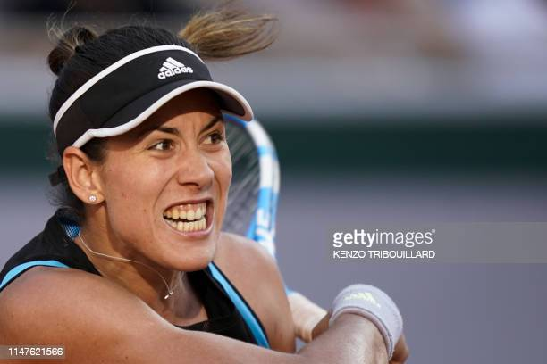 Spain's Garbine Muguruza reacts as she plays against Sloane Stephens of the US during their women's singles fourth round match on day eight of The...