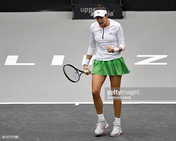 Spain's Garbine Muguruza reacts during her match against Turkey's Cagla Buyukakcay at the Generali Ladies Tennis Tournament in Linz Austria on...