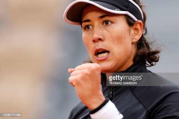 Spain's Garbine Muguruza reacts during her women's singles first round tennis match against Slovenia's Tamara Zidansek on Day 2 of The Roland Garros...