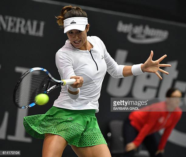 Spain's Garbine Muguruza returns a ball during the match against Turkey's Cagla Buyukakcay at the WTA Generali Ladies Tournament on October 12 in...