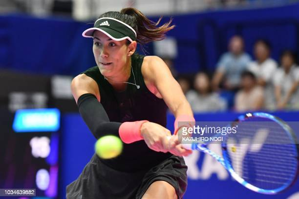 Spain's Garbine Muguruza returns a shot against Switzerland's Belinda Bencic during their women's singles first round match at the Pan Pacific Open...