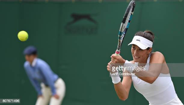 TOPSHOT Spain's Garbine Muguruza returns against Russia's Ekaterina Alexandrova during their women's singles first round match on the second day of...